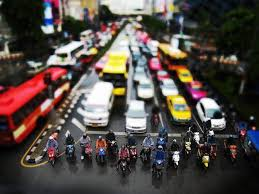 In Bangkok, motorcycles routinely slip to the front