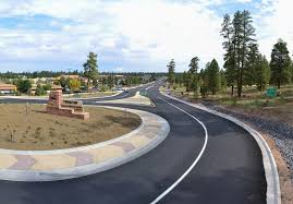 In a two lane roundabout, the outside lane is for turning off and the inside land is for carrying on around