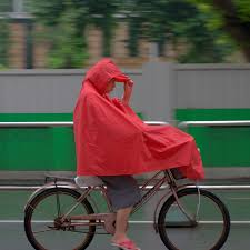 Wind is why umbrella raingear works on a bicycle but not a motorbike